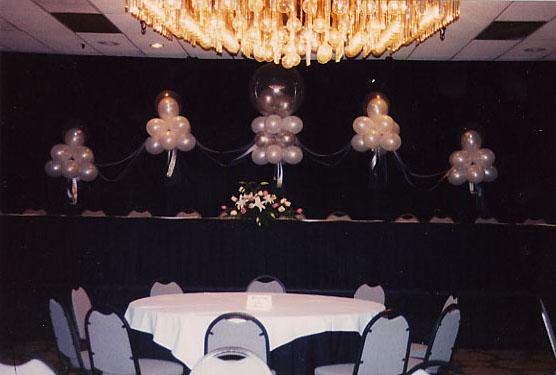 Lighted pedestal with garland arch at Doubletree Hotel